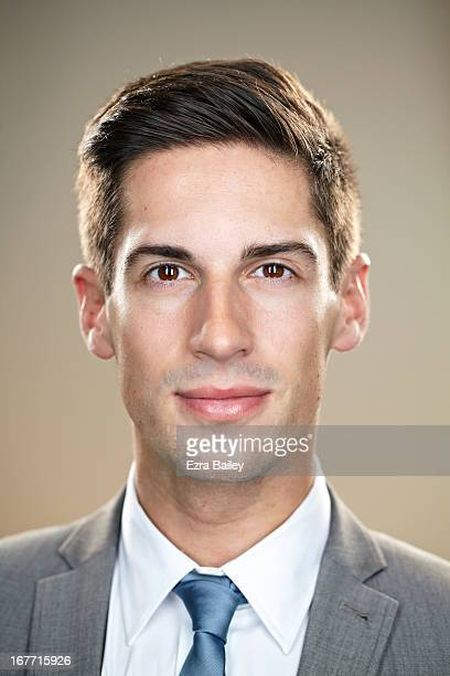 Portrait of a businessman looking into camera.
