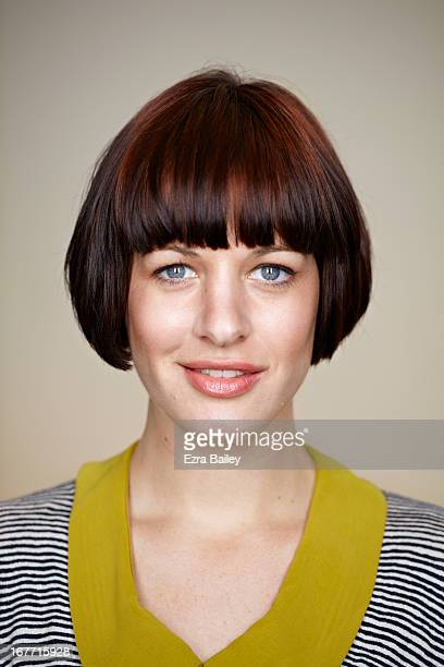 Portrait of woman smiling into camera.
