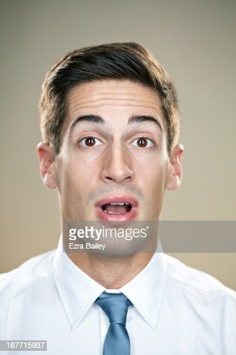 Portrait of a businessman looking shocked.