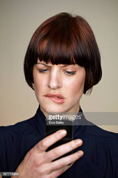 Portrait of a woman checking her phone.