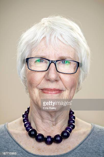 Portrait of a woman in glasses looking into camera