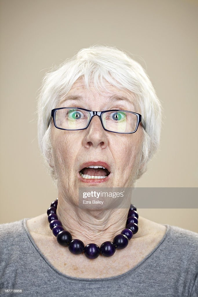 Portrait of an elderly lady looking surprised. : Stock Photo