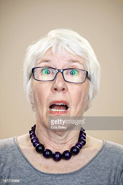 Portrait of an elderly lady looking surprised.