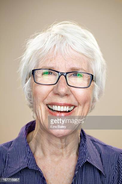 Portrait of an elderly lady laughing.