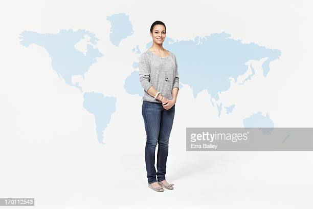 Woman standing in front of world map.