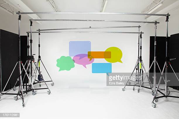 Perspex speech bubbles hanging in a studio.