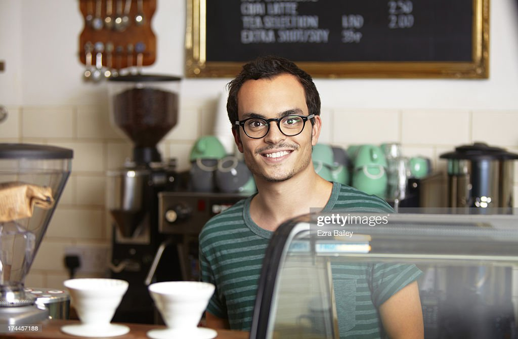 Portrait of an owner of a coffee shop. : Stock Photo