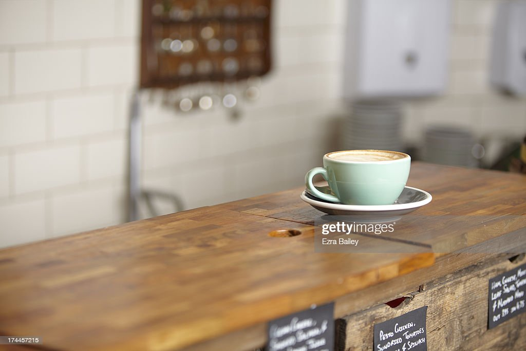 Cup of coffee in a mint green mug. : Stock-Foto