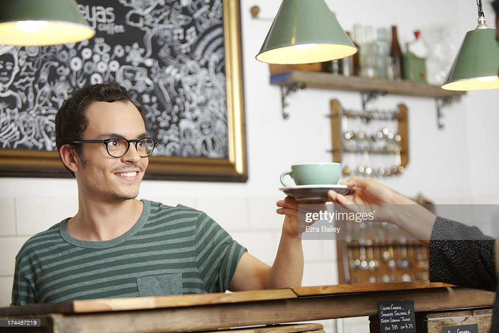 Man serving a cup of coffee. : Stock Photo