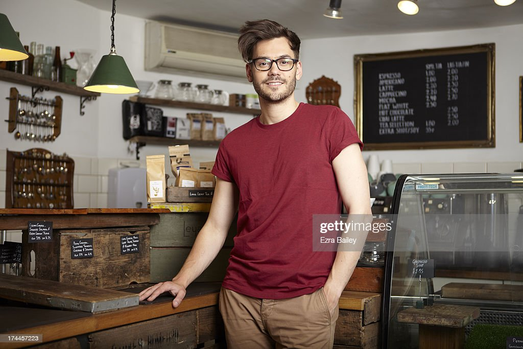 Portrait of the owner of a coffee shop : Stock Photo
