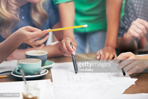 Employees discussing plans. : Stock Photo