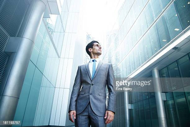 Businessman looking up at city skyline