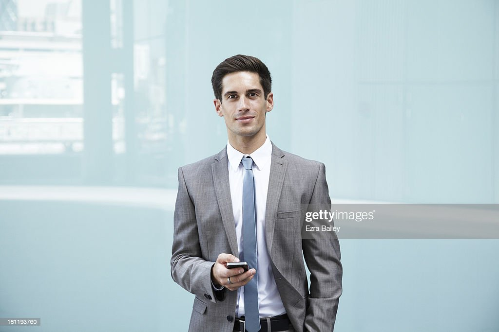 Portrait of a businessman with mobile phone