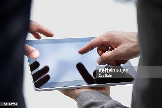 2 business men working on a tablet