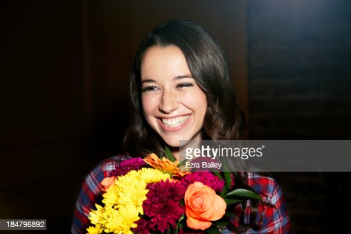 Woman smiling with a bunch of flowers. : Stock Photo