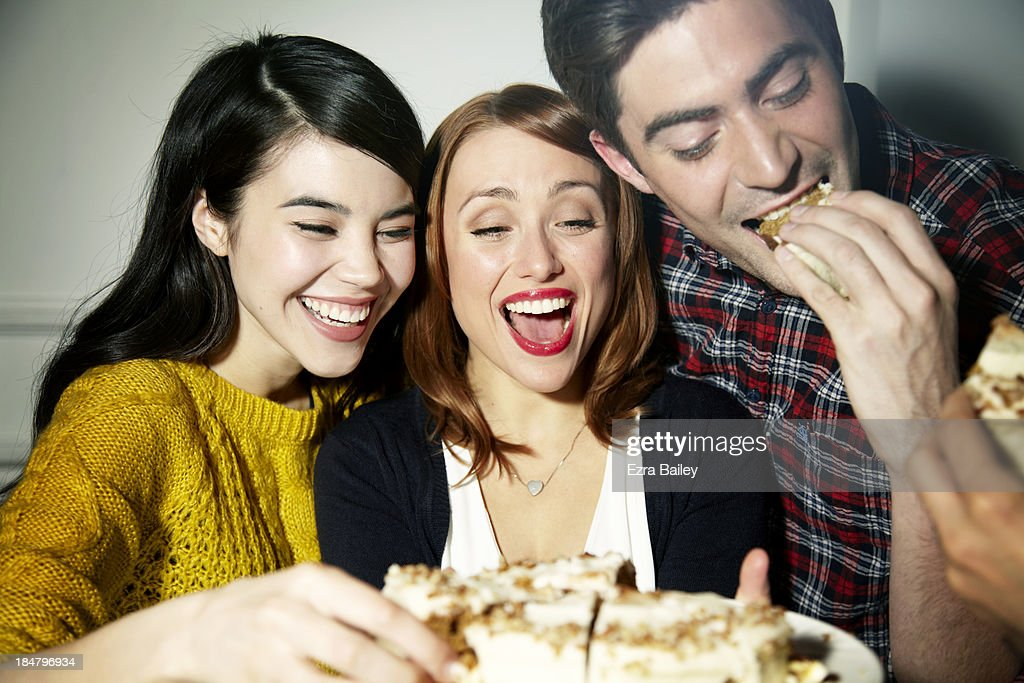 Friends eating cake and laughing.