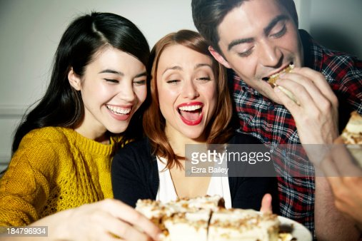 Friends eating cake and laughing. : Stock Photo