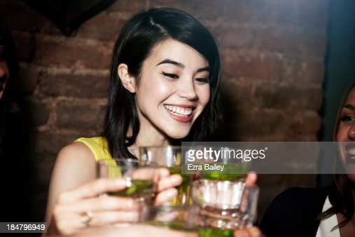 Woman celebrating with cocktails with friends.