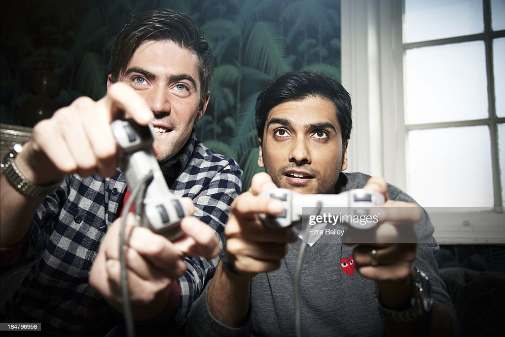Friends in competition playing games console.