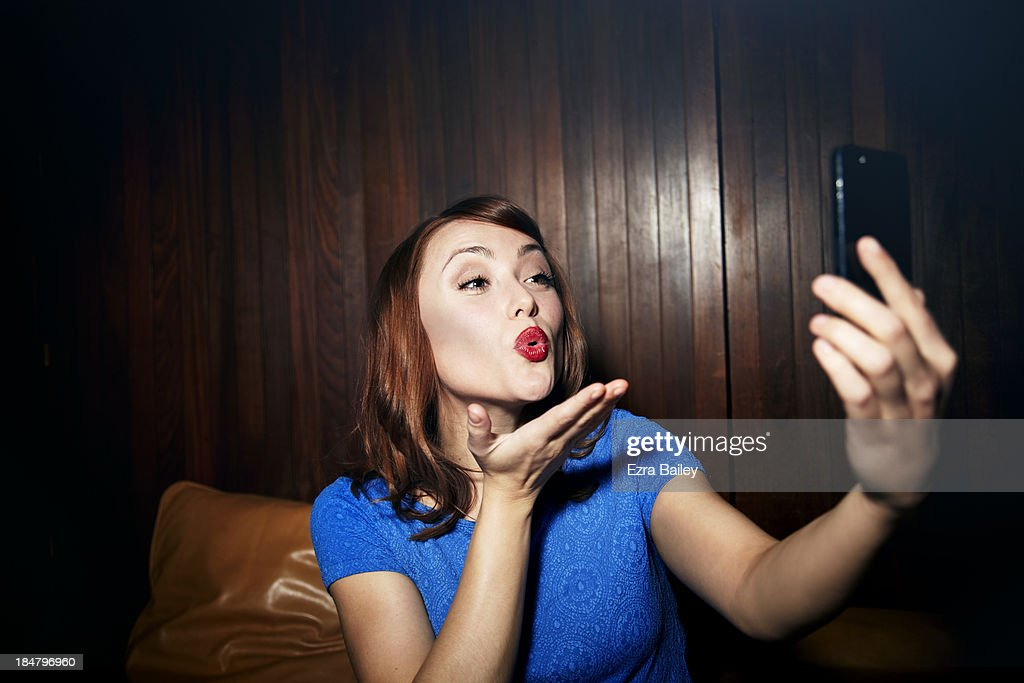 Woman posing and taking a photo of herself