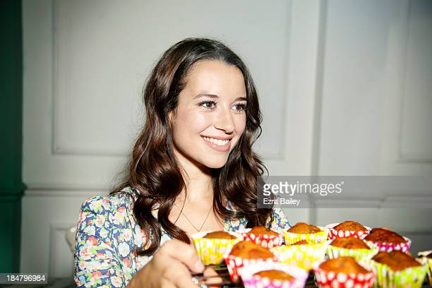 Woman with a tray of cupcakes