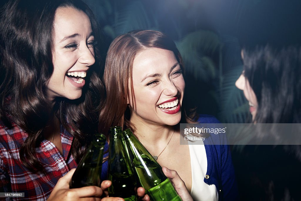 Girlfriends celebrating at a party : Stock Photo