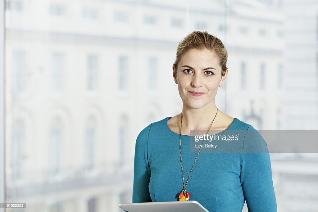 Portrait of a business woman looking into camera. : Stock Photo