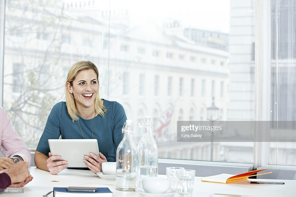 Business woman working on a digital tablet. : Stock Photo