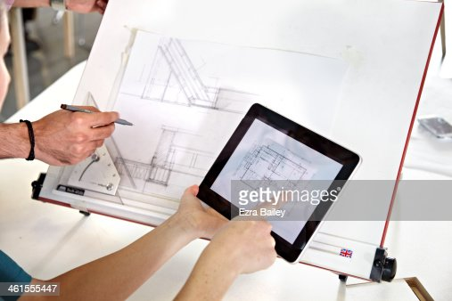 Designer drawing plans from a digital tablet : Stock Photo