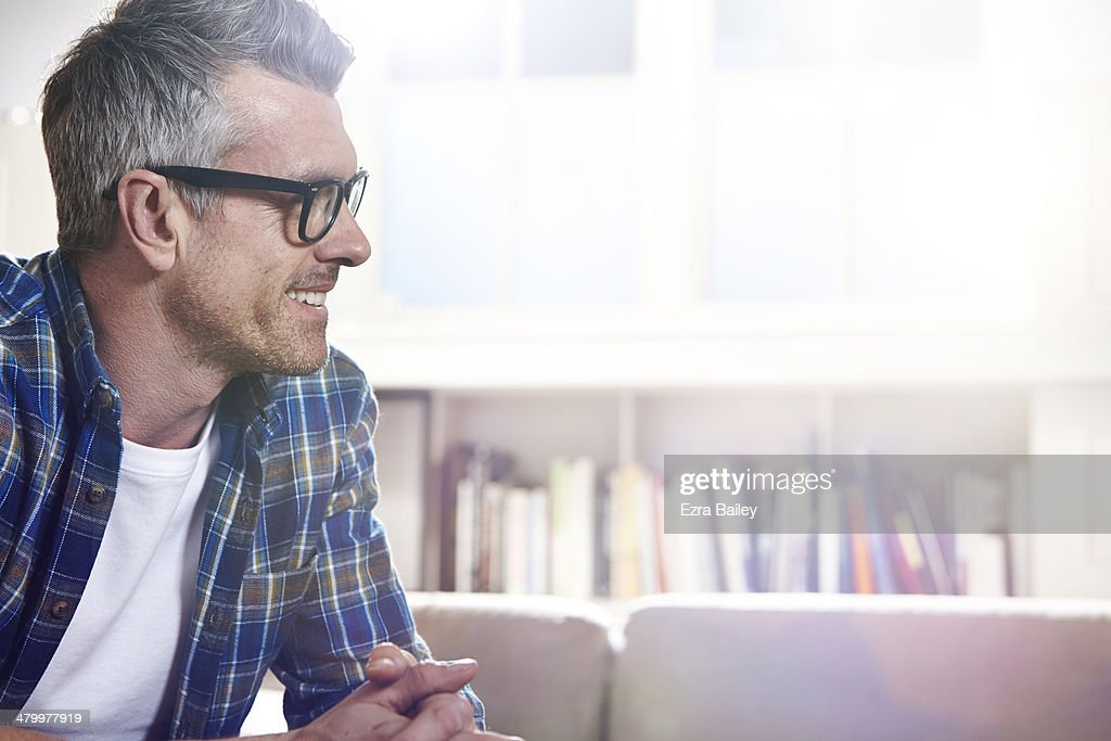Man chatting while relaxing at home. : Stock Photo
