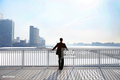 Businessman looking out over the city.