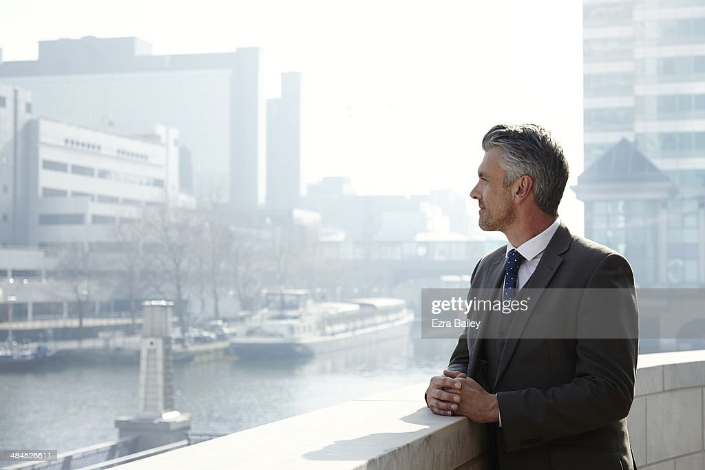 Business man looking out over the city.