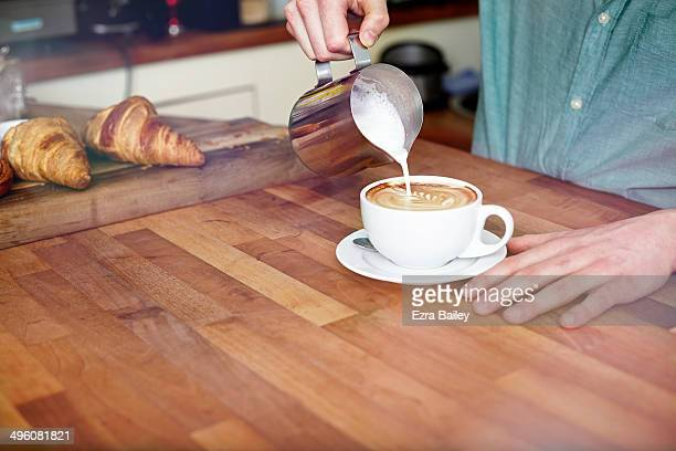 Man making a perfect coffee.