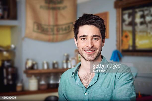 Portrait of a coffee shop owner