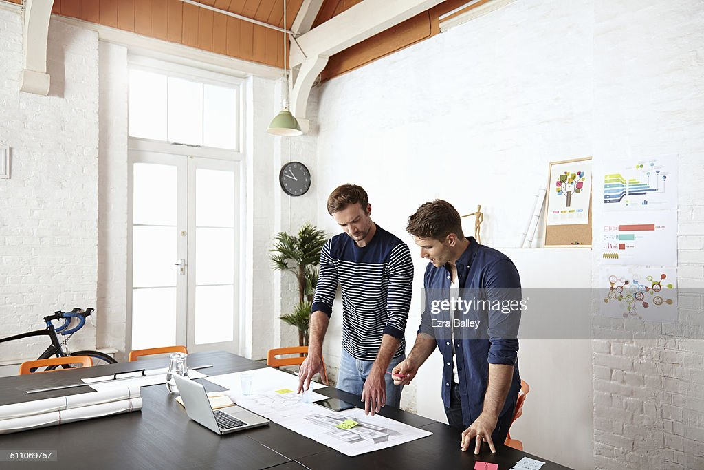 Two colleagues brainstorming in creative office