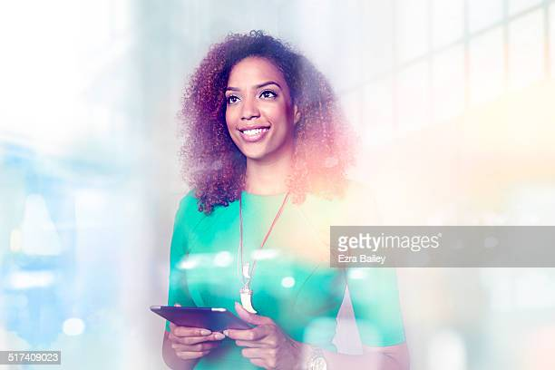 Female employee looking out of glass office window