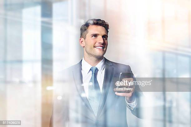 Successful businessman looking out of a window.