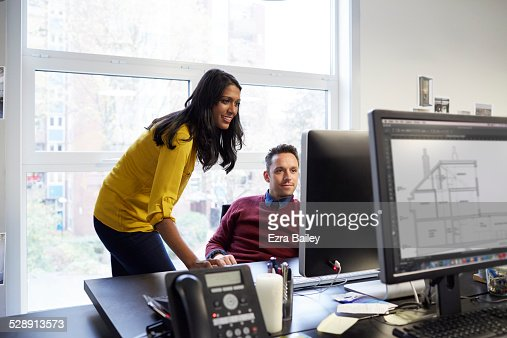 Two colleagues working in a creative office.