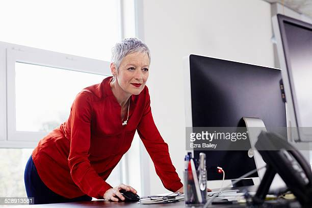 Mature business woman working on a computer.
