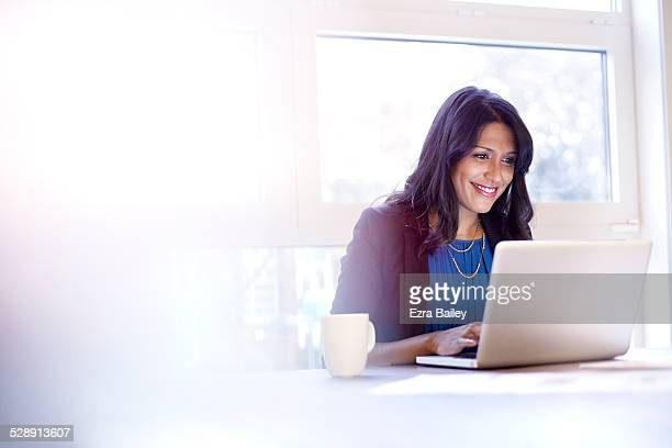 Young business woman working on a laptop.