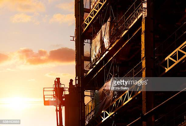 Construction worker working at sunset