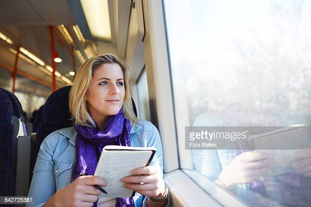 Woman on a train looking out the window.