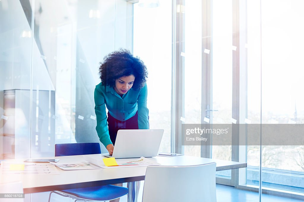 Woman working in modern glass office : Stock Photo