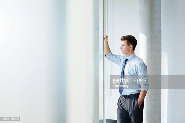 Businessman thinking as he looks across city