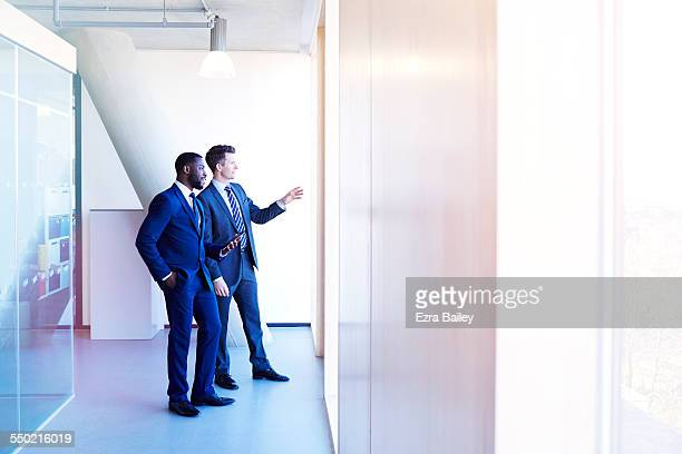 Two businessmen discussing view before meeting