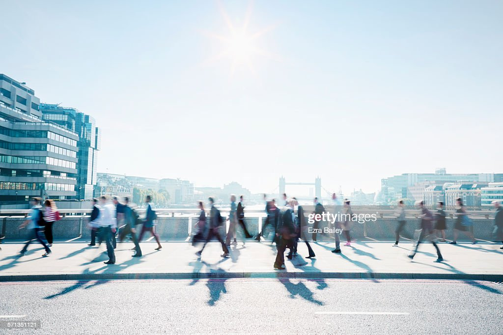 Workers walking to work through the city.