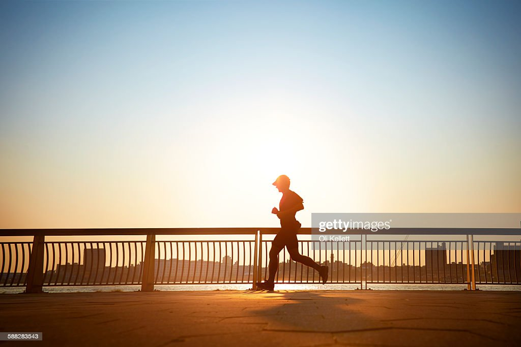Man enjoying an early morning jog in the city. : Stock Photo