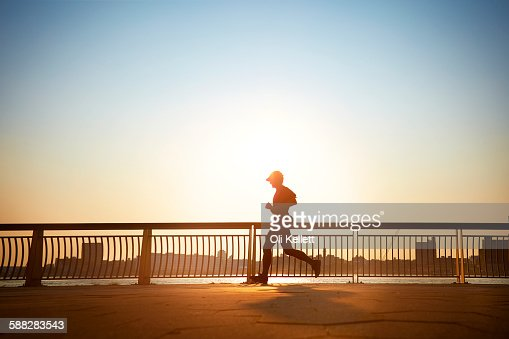 Man enjoying an early morning jog in the city.