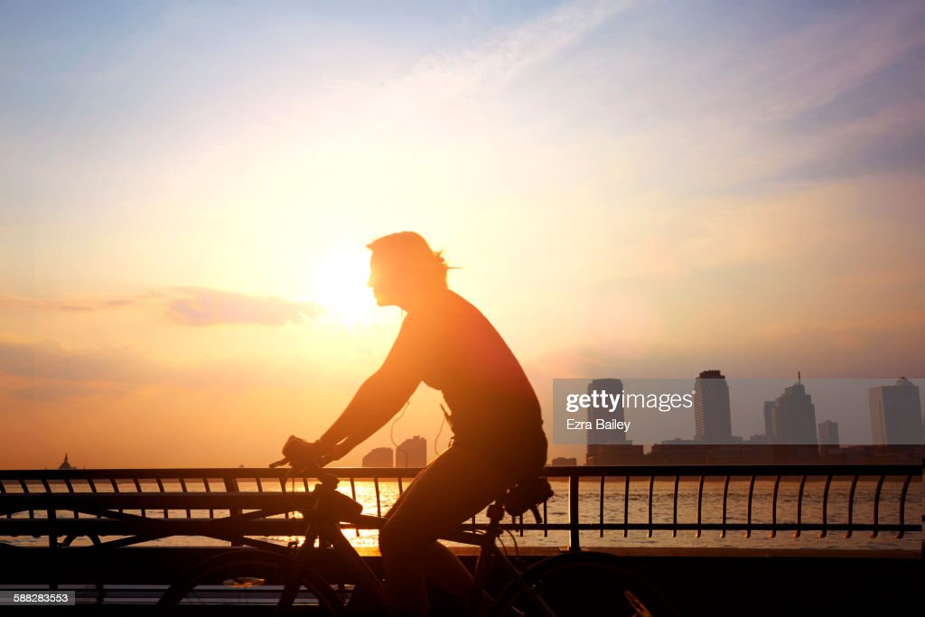 Commuter cycling to work in the morning. : Stock Photo