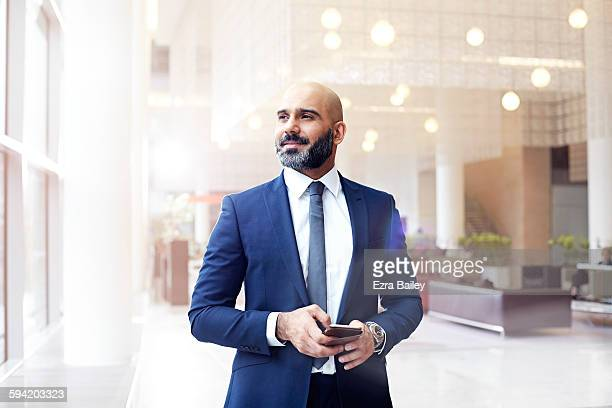 Businessman looking out a window in modern office